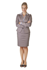 Caucasian blond businesswoman in suit on white isolated backgrou